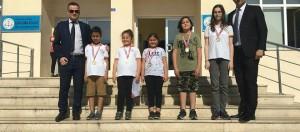 """""""TÜRKİYE BİRİNCİSİ"""" olan öğrencilerimize bugünkü törende madalyalarını takdim ettik."""